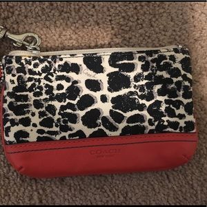 Red, black and white animal print Coach wristlet